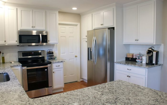 this shows the stove, refrigerator, and coffee nook in kitchen remodel
